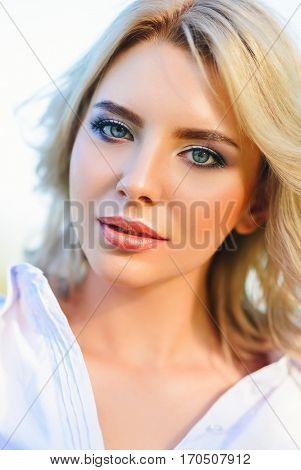 Outdoor closeup portrait of beautiful young girl