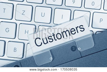 Customers - folder with text on computer keyboard