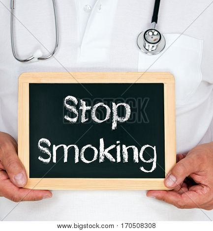 Stop Smoking - Doctor holding chalkboard with text