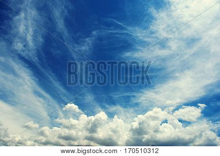 Clouds dancing in the sky. Blue and white harmony