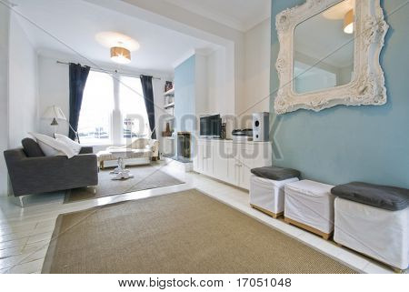 designer living room in light blue with luxury elements