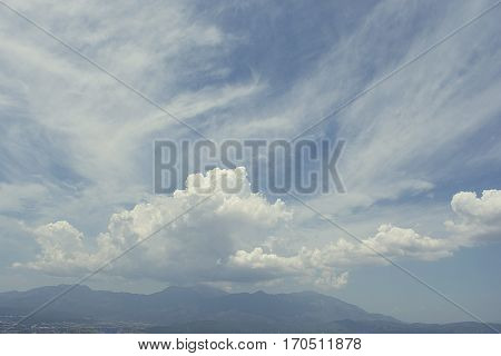 Clouds over distant mountains. The clouds are dancing