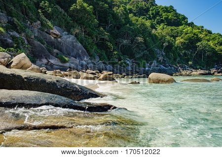 Foamy waves on the Koh Similan No.8 Island in Similan National park, Andaman Sea, Thailand. Beautiful landscape with the rock and trees.