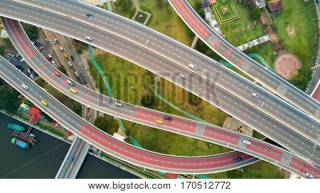 Top aerial view of a large road interchange at the Bhumibol bridge in Bangkok, Thailand