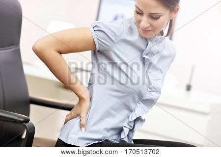Picture showing businesswoman suffering from backache