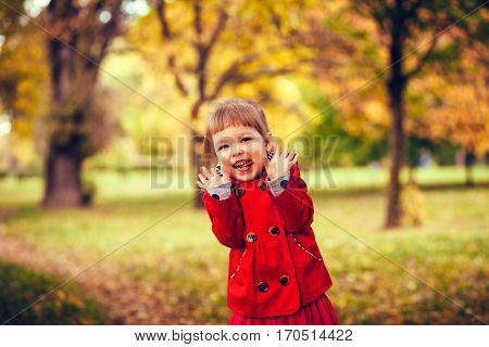 Laughing happy girl. Portrait on beautiful autumn day