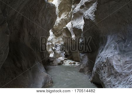 A steep and deep canyon has been formed with the help of cracks in the calcareous area.