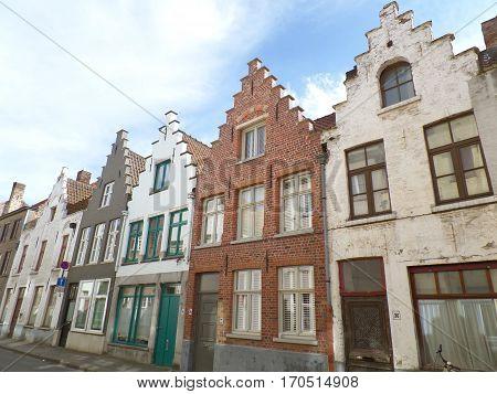 Brown and white tone vintage bricked buildings in Bruges, Belgium