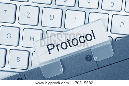 Protocol folder with text on computer keyboard