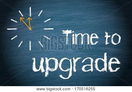 Time to upgrade - text with clock on blue background