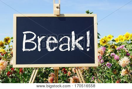 Break - easel with text and flowers in the background