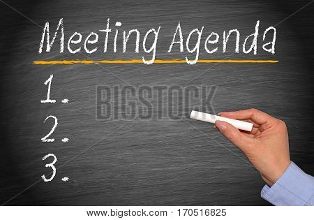 Meeting Agenda - female hand with text and checklist