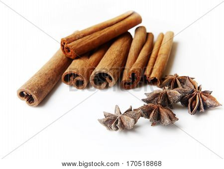 Anice and cinnamon isolated on white close up