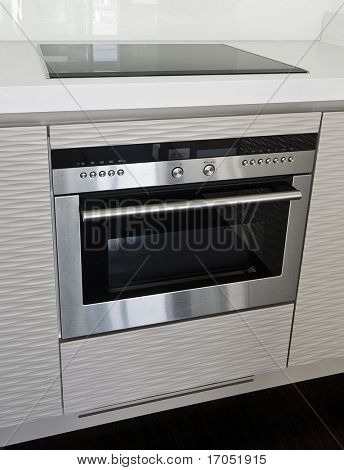 modern electric stove and oven in stainless steel finish