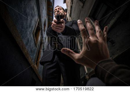 Mafia killer murdering an innocent