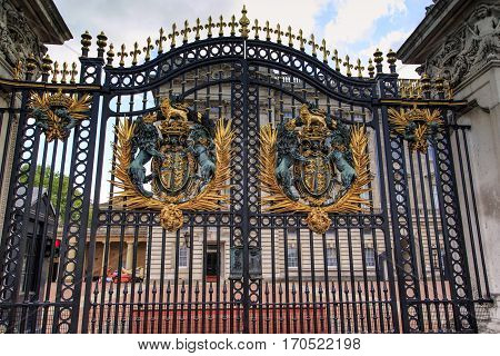 LONDON, GREAT BRITAIN - MAY 9, 2014: This is the royal arms of England on the gate railings of Buckingham Palace.