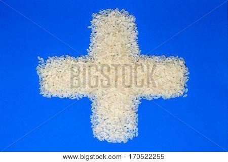 Basmati white uncooked rice on blue background. minimalism background isolated