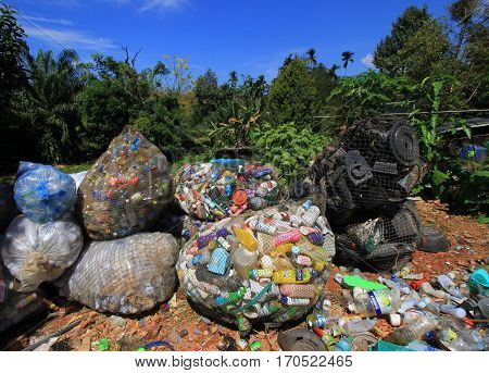 KHAO LAK, THAILAND - 05 FEBRUARY 2017: Environmental problem. Cans, bottles and plastic containers dumped in landfill due to inadequate recycling.