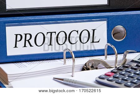 Protocol - blue binder with text on desk in the office