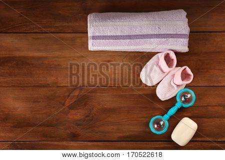 Baby necessities on wooden background
