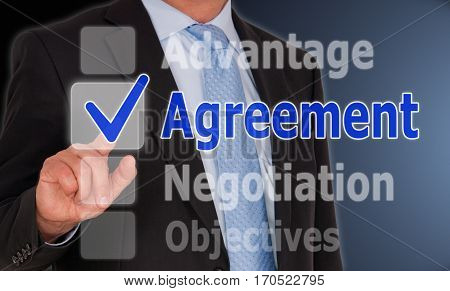 Agreement - Businessman with touchscreen options and checkbox