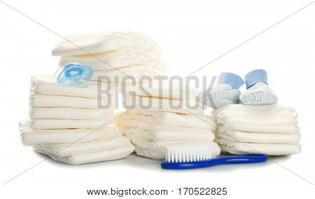 Baby diapers and necessities on white background