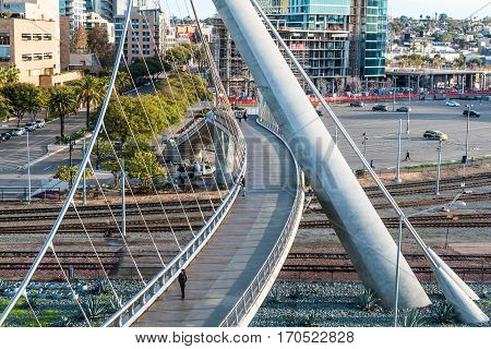 SAN DIEGO, CALIFORNIA - JANUARY 8, 2017:  People using the Harbor Drive pedestrian bridge, known was one of the longest self-anchored pedestrian bridges in the world.