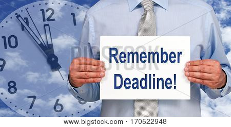 Remember Deadline - Businessman holding sign with text, clock in the background