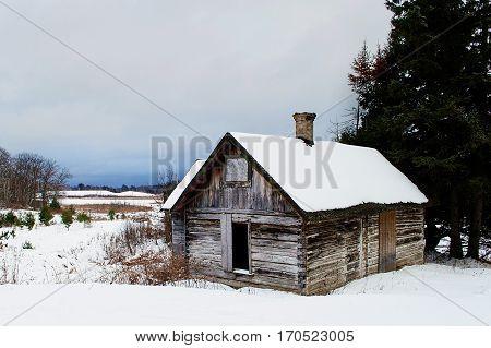 Snow covered shack on a frigid Minnesota winter day