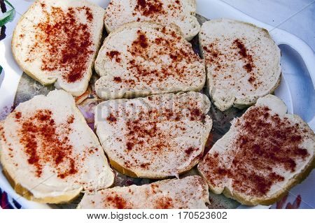 Traditional Banat food bread with lard and sprinkled with red of ground pepper.
