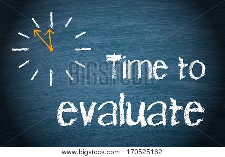 Time to evaluate - clock with text on blue background