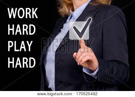 Work hard play hard - Businesswoman with touchscreen checkbox