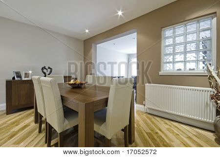 modern dining room with hard wood table and leather chairs