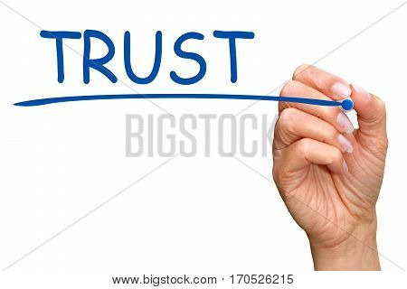 Trust - female hand with blue marker writing text on white background