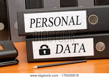 Personal Data - Data Security - two binders on desk in the office