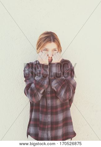 Young Woman With Hands Over Face In Retro Style Portrait