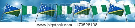 Solomon islands flag with Nigeria flag, 3D rendering