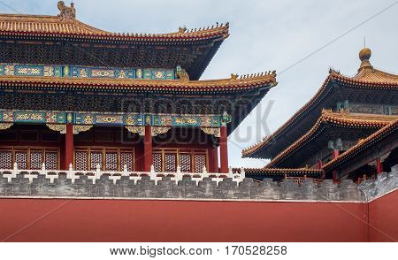 Beijing, China - Oct 30, 2016: At Meridian Gate (Wumen) area, Forbidden City (Gu Gong, Palace Museum). Tiled roof and facade decorated with Chinese pattern. A hazy day.