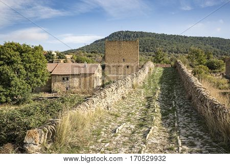 ancient bridge over las Truchas river in Pobleta de San Miguel village, Villafranca del Cid, province of Castellón, Spain