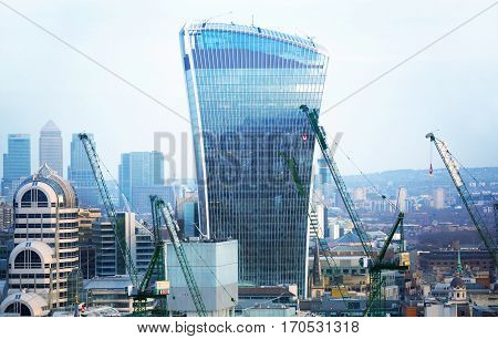 London, UK - December 19, 2016: City of London business and banking aria at sunset. View includes Walkie-Talkie and Canary Wharf at the background. Modern skyscrapers of leading financial companies