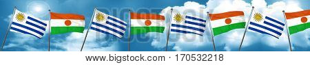 Uruguay flag with Niger flag, 3D rendering