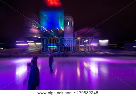Motion blurred picture of an ice rink with skaters