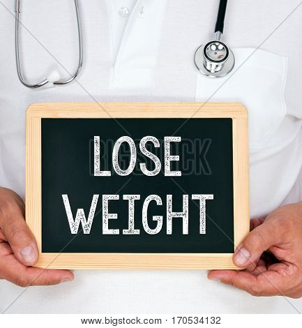 Lose Weight - Doctor holding chalkboard with text
