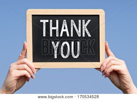 Thank You - female hands holding chalkboard with text