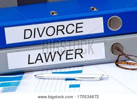 Divorce and Lawyer - two binders on desk in the office