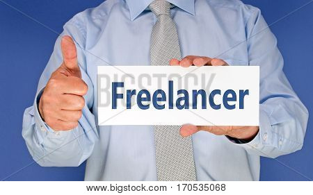 Freelancer - Businessman with sign and thumb up