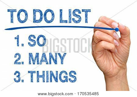 To Do List - So Many Things - hand with blue marker writing text on white background