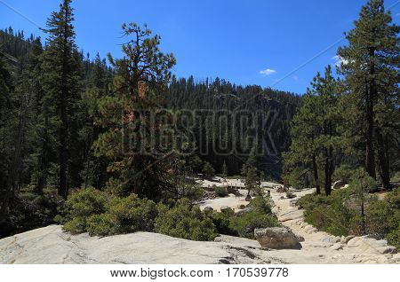 YOSEMITE NATIONAL PARK - SEP 22: Hikers explore the area at the top of Nevada Falls on Sep 22, 2015 in Yosemite National Park. Nevada Falls is located at the west end of Little Yosemite Valley.
