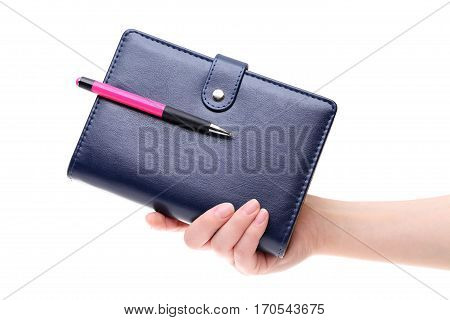 Hand holding blue leather notebook isolated on white background