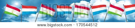 Tajikistan flag with Luxembourg flag, 3D rendering